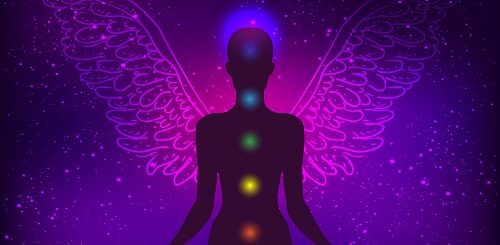 Silhouette of angel with chakras illuminated