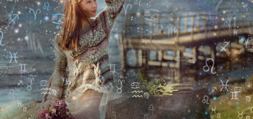 Brunette woman by a lake with zodiac signs around her